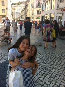 At one of my favorite places where my mom used to go as a child, the Baixa.Olivia and Mialotta.