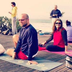 Doug and Maria on the beach doing yoga in Carcavelos with a German yoga teacher! :)