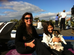 "Doing more yoga. This time on the beach in Carcavelos with Mialotta and our new doggie ""Tejo"""