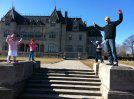 Christophino and his sisters pretending they are statues at a Newport mansion.